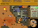 An already crippled Atreides base is under attack by Harkonnen forces. (image by Westwood Studios)